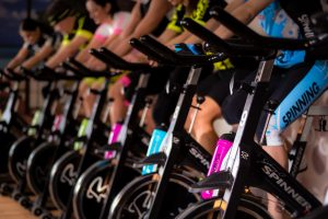 Several people riding stationary bikes to help fight ageing process